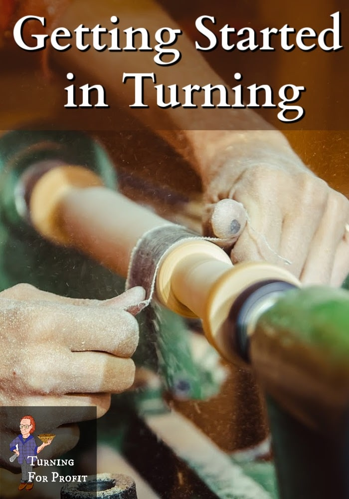 Hands sanding wood on a lathe