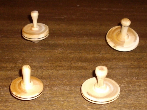 Handmade wooden spinning tops