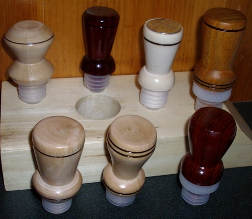 A variety of wine bottle toppers.