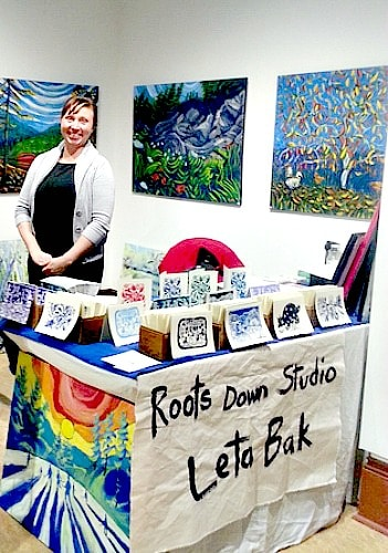 Craft Show - Grand Forks artist Leta Bak with her paintings
