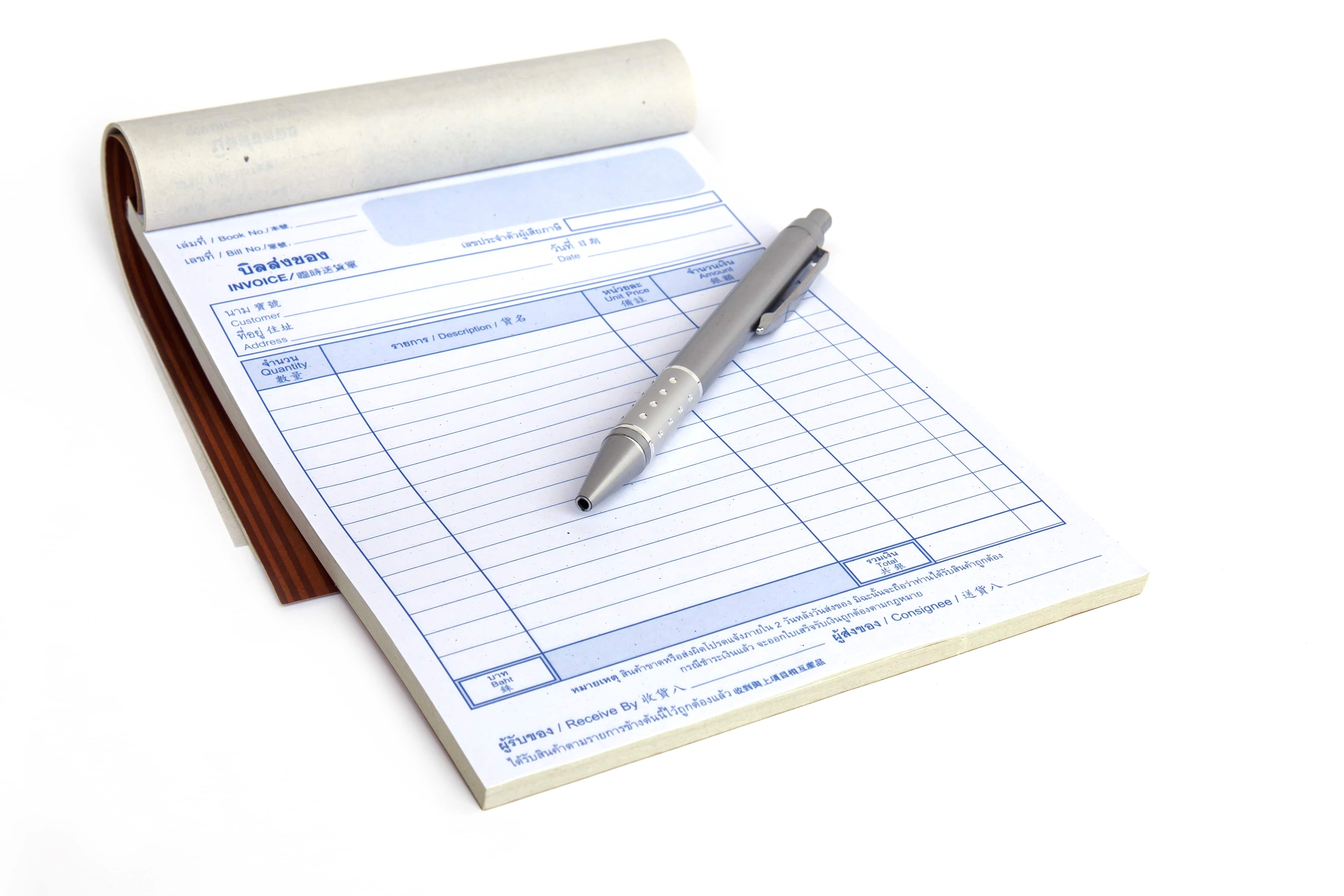 invoice book with open blank page and pen