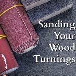 a collection of sandpaper and sanding blocks