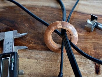 A wooden grommet for your home office computer chords