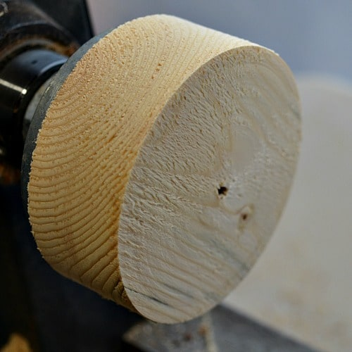wood on a face plate of lathe