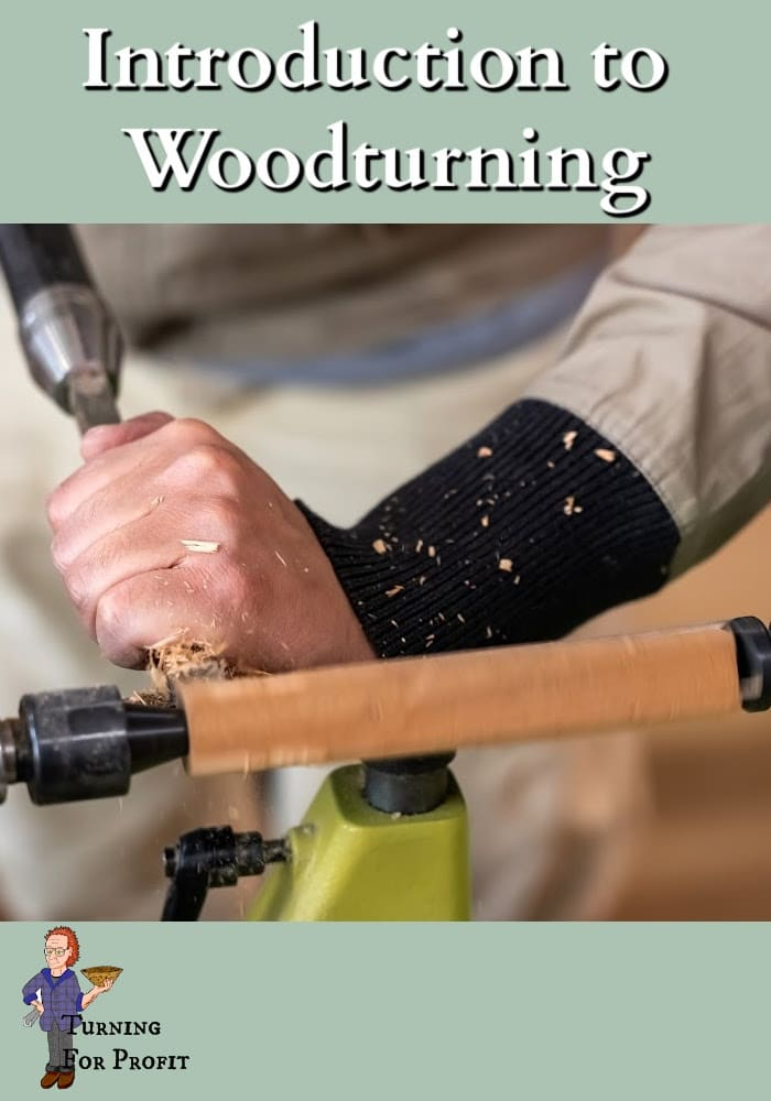 Hands working wood on a lathe